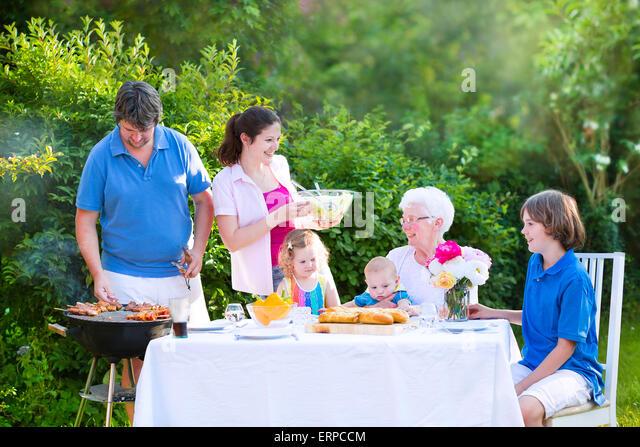 Big Brother Backyard Bbq : Grill barbecue backyard party Happy big family enjoying BBQ lunch