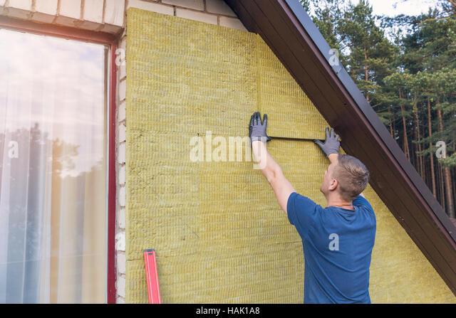 House insulation facade stock photos house insulation for Wool house insulation