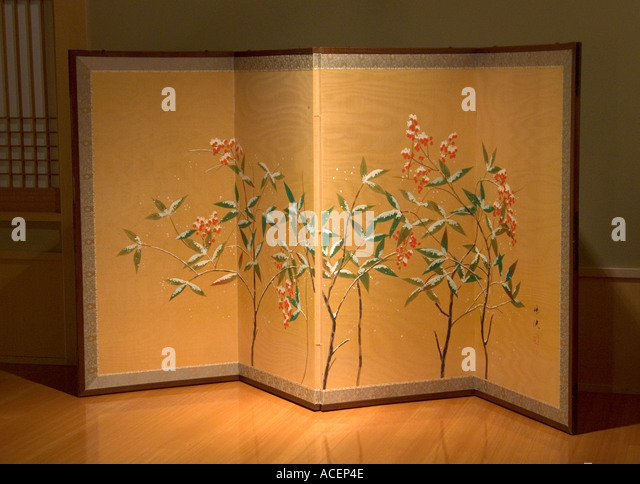 antique folding screen with winter flower scene against gold background stock image