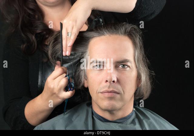 Man Getting Long Hair Cut Stock Photos & Man Getting Long Hair Cut ...