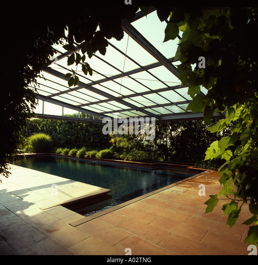 Modern terracotta stock photos modern terracotta stock for Indoor pool with retractable roof