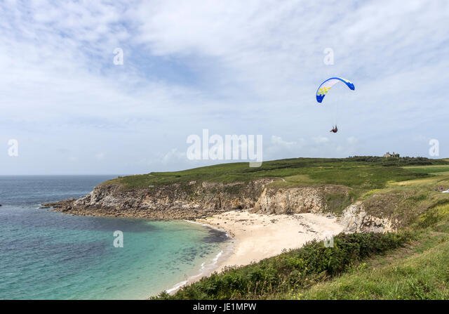 Paraglider Soaring Above the Coast at the Pointe de Corsen, Plouarzel, Bittany, France - Stock Image
