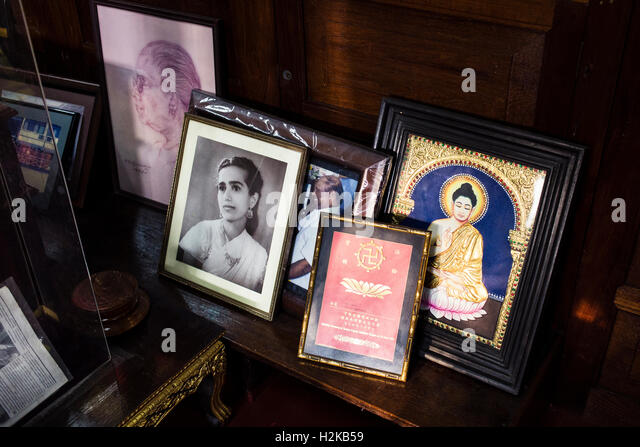 Portraits Of A Guru Are Seen At The Gangaramaya Temple On Sinhala New Year