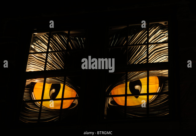huge scary eyes light up the window of a halloween decorated house in oklahoma - Light Up Halloween Decorations