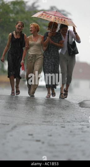 Girls Caught In The Rain Stock Photos & Girls Caught In ...