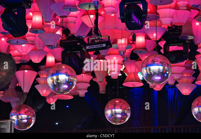 Hanging disco ball ceiling stock photos hanging disco ball spinning disco balls and lots of pink lights hang from the ceiling of a nightclub on aloadofball Image collections
