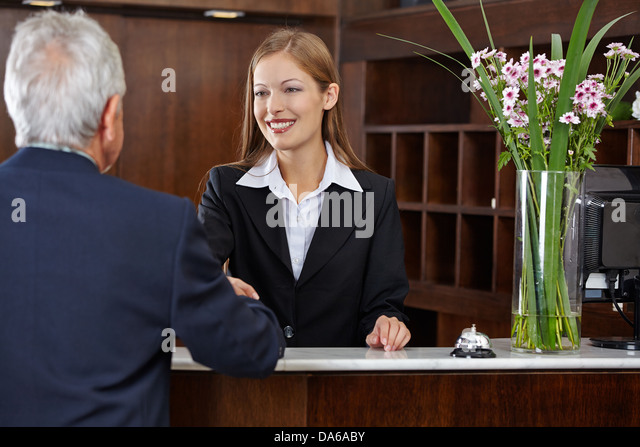 Female hotel employee guest stock photos female hotel for Aby mackie salon little rock