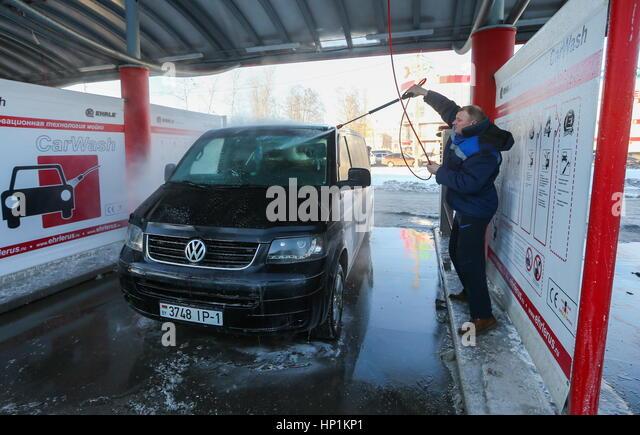 Self serve car wash stock photos self serve car wash stock images a man washes his vehicle at an solutioingenieria Choice Image