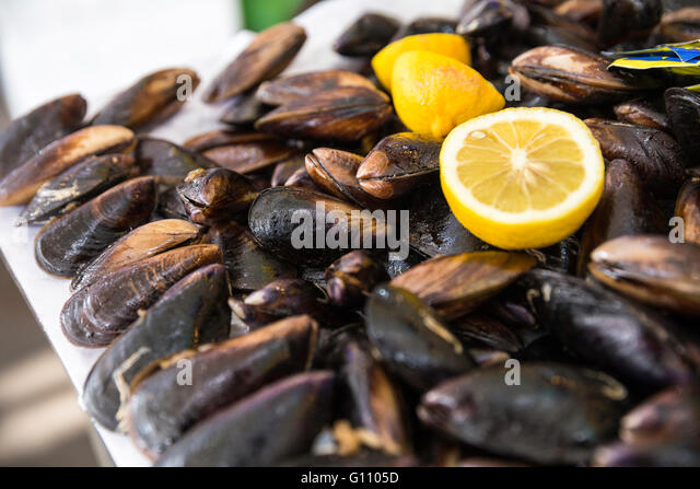 Turkish style stuffed mussels called midye dolma on the bench for sale ...