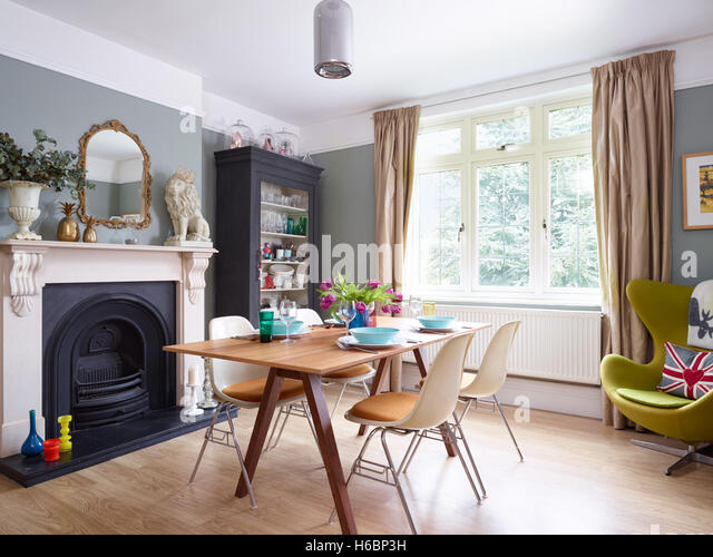 An Eclectic Stylish Dining Area With Victorian Period Fireplace Features In Gloucestershire UK