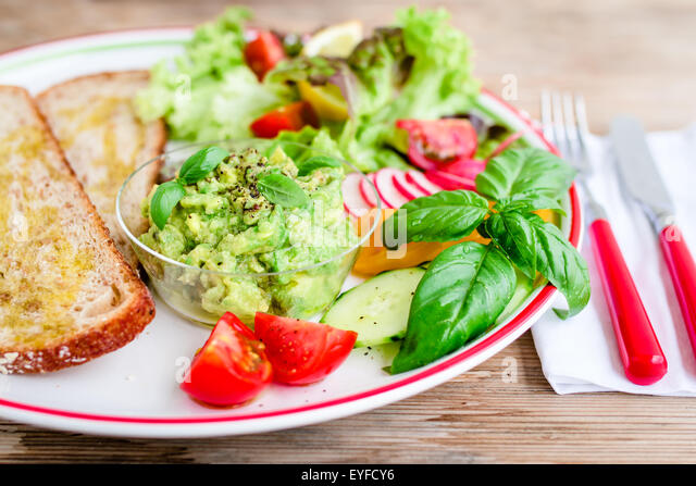 Plate With Bread And Fresh Vegetables For Vegan Breakfast Lunch Stock Image