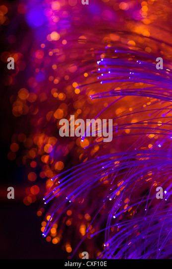 Coloured Fibre Optic Strands With Out Of Focus Lights In The Background    Stock Image