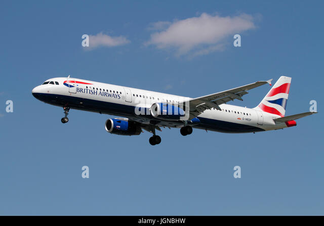 Civil aviation. British Airways Airbus A321-200 on approach against a blue sky - Stock Image
