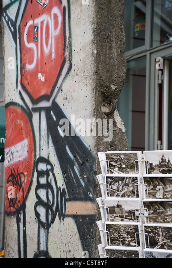 Germany, Berlin, House wall, graffiti and post cards - Stock Image
