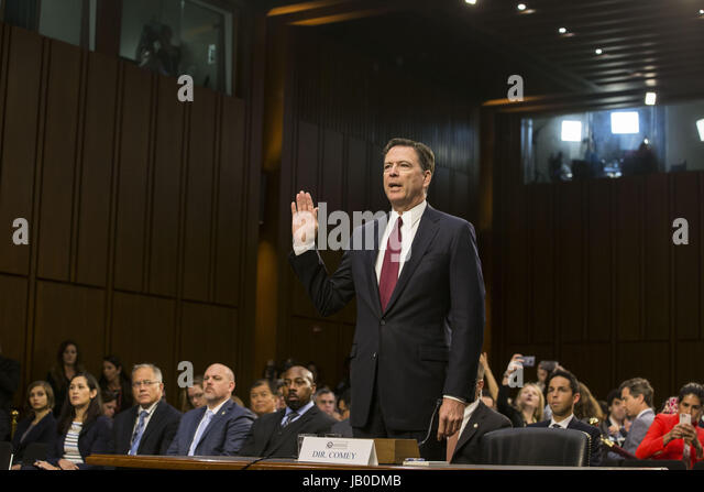 Washington, District Of Columbia, USA. 8th June, 2017. Former FBI Director JAMES COMEY is sworn in prior to his - Stock Image