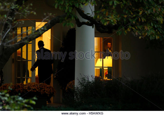 us president barack obama enters the oval office of the white house upon his return from barack obama enters oval