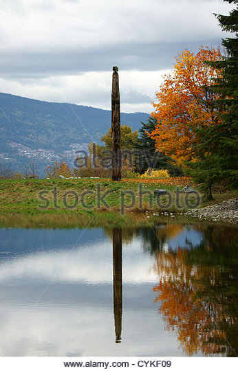lone-west-coast-totem-pole-reflected-in-