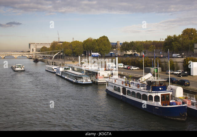 France, Paris, Port de Bercy tourboats by National Library, morning - Stock Image