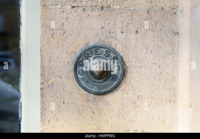 Old Fashioned Vintage Brass Door Bell On Cotswold Stone House   Stock Image