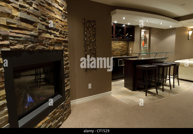 Luxurious Residential Basement Bar With Fireplace.   Stock Image