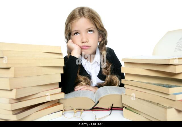 Unhappy Student Sitting At Desk