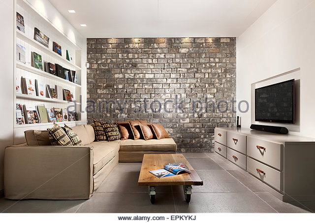 Living Room With Grey Brick Wall In Villa By Gadi Fiedman Israel