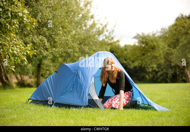 A girl in a tent in an orchard c&site in Herefordshire UK - Stock Image & Camping Tents Female Woman Stock Photos u0026 Camping Tents Female ...