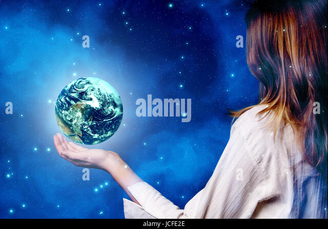 woman holding a planet earth in her hand, save our planet concept - Stock Image