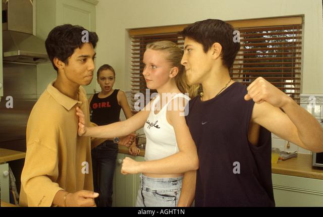 teenage boys fighting girls