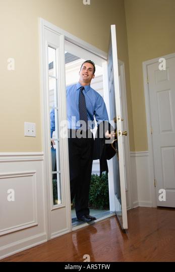 People Opening Doors : People arriving at front door stock photos