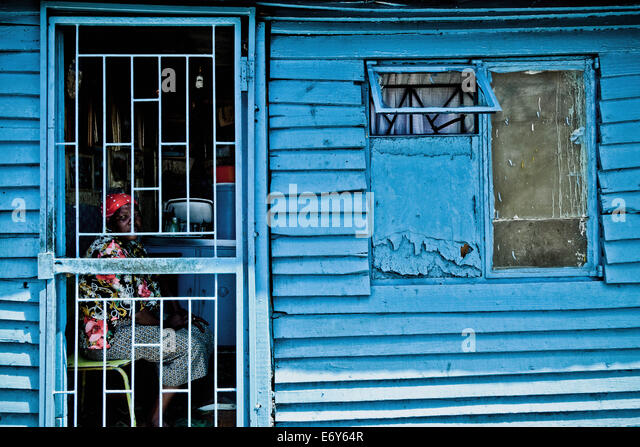 Woman sitting in her hut behind a barred door Langa township Cape Town & Door Of A Hut Stock Photos \u0026 Door Of A Hut Stock Images - Alamy