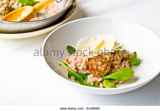 Risotto rosso (Red risotto with lamb meatballs, Italy) - Stock Image