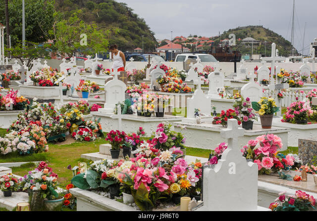 Grave flowers stock photos grave flowers stock images alamy families place silk flowers on the graves of their deceased relatives in the graveyard on the mightylinksfo