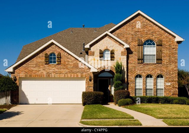 Two story home garage stock photos two story home garage for Pretty two story houses