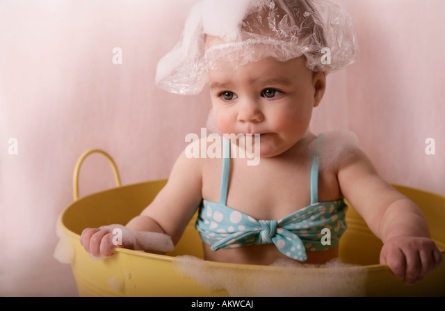 Baby With Shower Cap And Bubbles   Stock Image