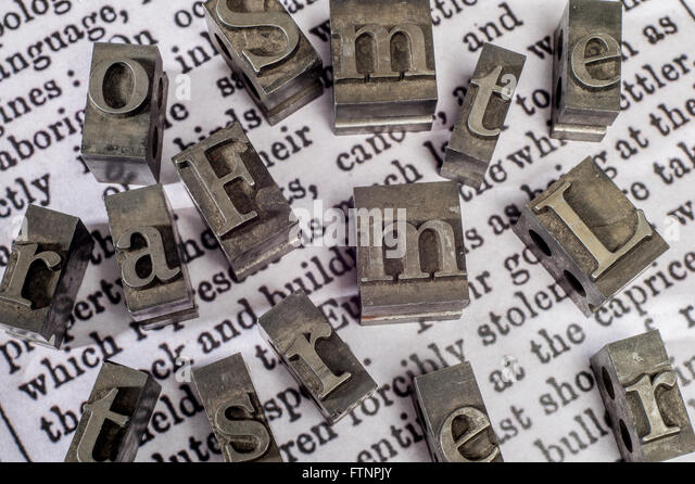 printing press block letters on newspaper print stock image