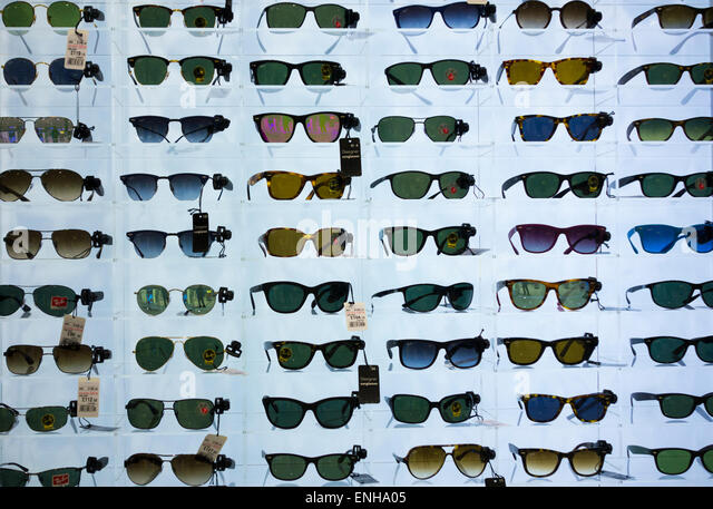 ray ban sunglasses kuala lumpur  ray ban sunglasses display in uk airport duty free shop. stock image