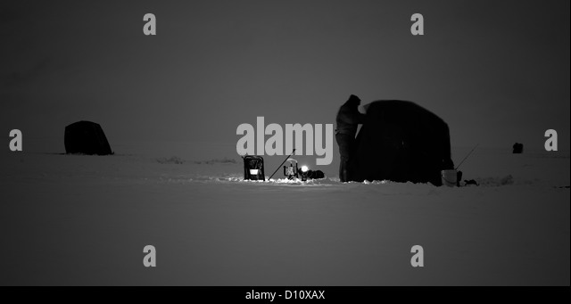 Ice fishing black and white stock photos images alamy for Ice fishing at night