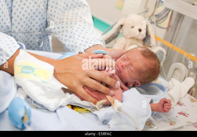 Fetal Position Bed fetal position baby stock photos & fetal position baby stock