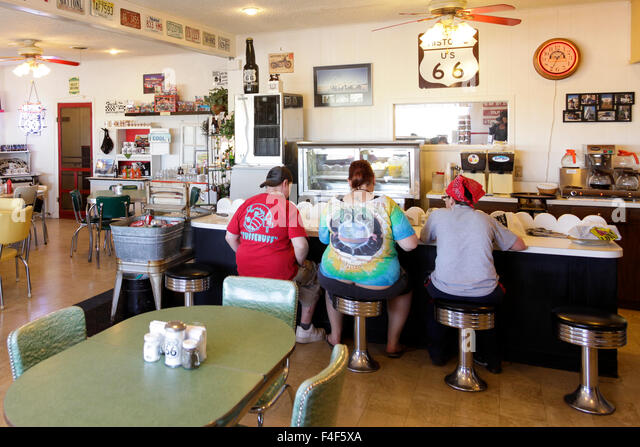 Retro Diner Stool Stock Photos amp Retro Diner Stool Stock  : interior of mid point cafe adrian texas usa route 66 midway point f4f5xa from www.alamy.com size 640 x 447 jpeg 105kB