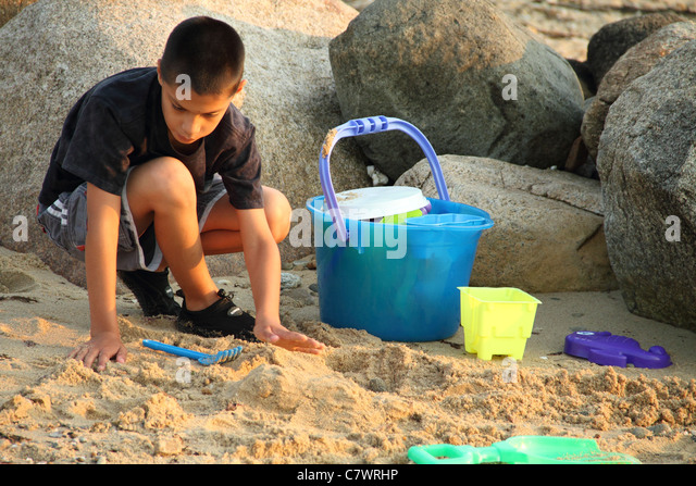 Digging Toys For Boys : Digging in sand stock photos