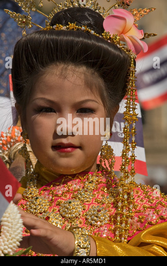 Thai girl made up and wearing traditional dance dress - Stock Image - thai-girl-made-up-and-wearing-traditional-dance-dress-ar5md1
