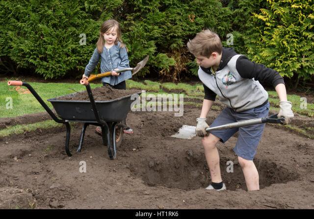 Digging hole garden stock photos digging hole garden for Digging a garden pond