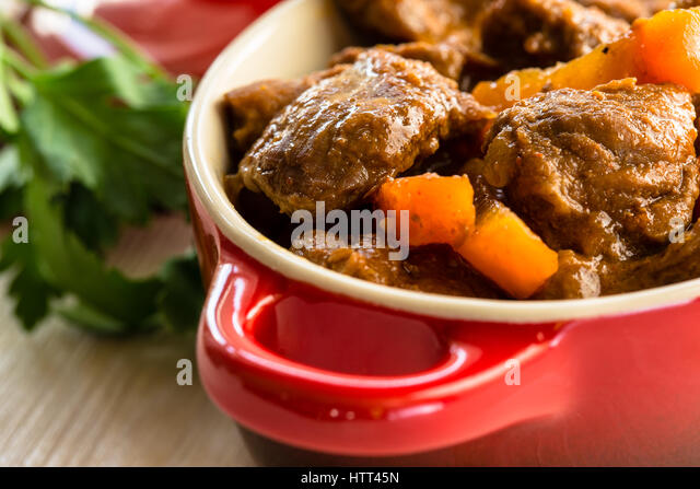 Beef Stew With Carrot Traditional French Beef Goulash In Red Ceramic Pot Stock Image