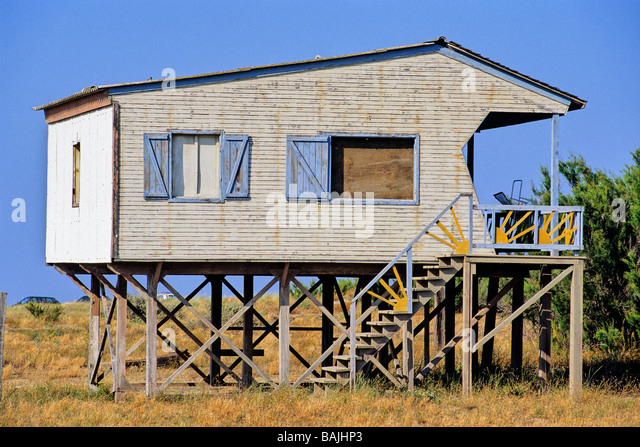 Structure on stilts stock photos structure on stilts for Log cabin homes on stilts