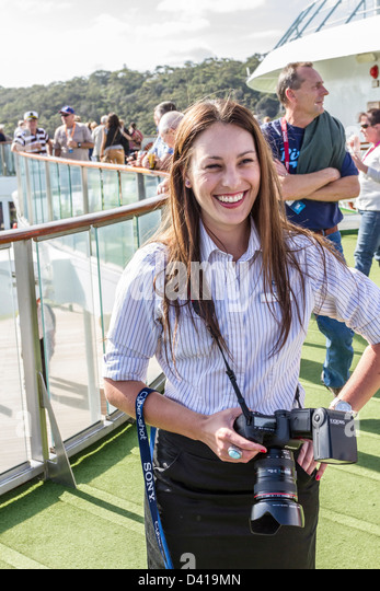 smiling cruise ship photographer on po pacific pearl taking pictures of passengers of departure from sydney