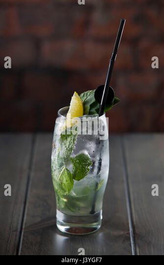 A mojito alcoholic cocktail seen on a table in a bar. - Stock Image