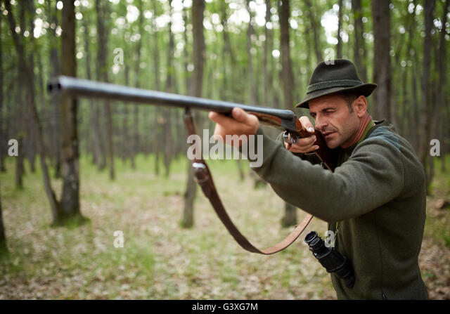 hunter-with-double-barrel-shotgun-in-the