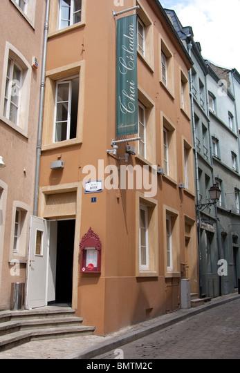 Narrow Street Peach Building Restaurant Steps Door   Stock Image