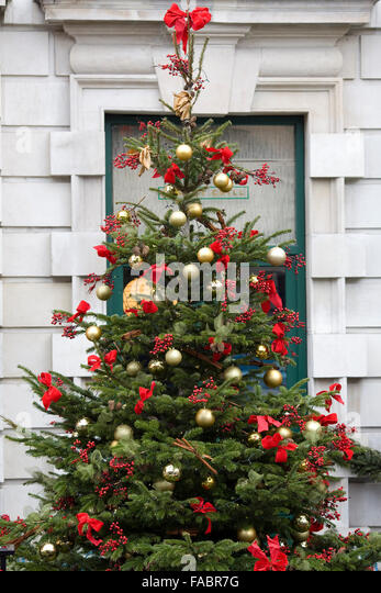 Baubles on christmas tree outside stock photos baubles for Large christmas baubles for outside